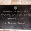 Earl Mountbatten of Burma is interred beneath a simple slate slab.