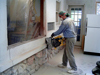 How to turn a window into a door. Gas powered saw with a diamond blade is needed to cut through masonry wall.