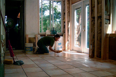 Rita, grouting floor tiles.