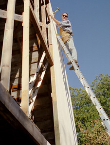 Gary, on a tall ladder, repairing the barn. October, 2008.