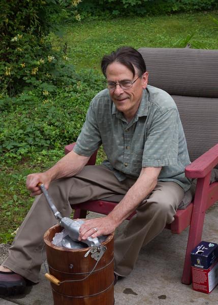 Gary hand Cranking ice cream on the patio. May 2016