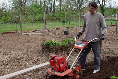 Gary, tilling the garden; April, 2011