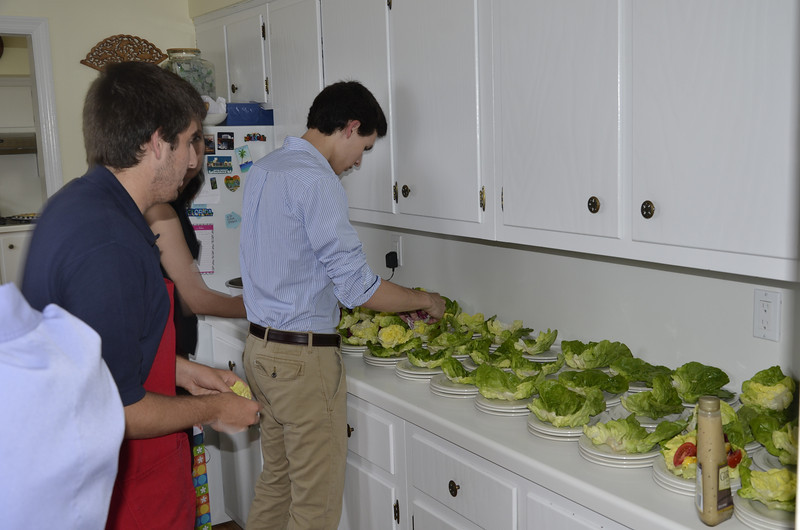 Students assisting in the meal preparation.