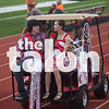 The community pep rally and Ring of Champions parades around the track at Wednesday,  Sept. at Argyle High School in Argyle, Texas. (Annabel Thorpe / The Talon News)