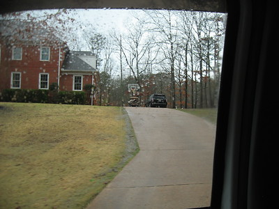 Golf cart parked in driveway.