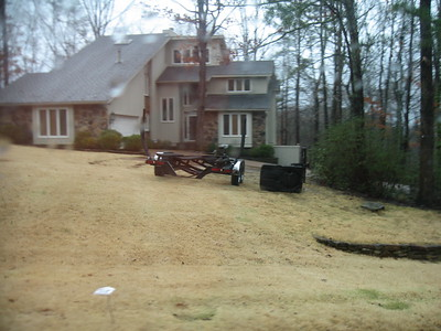 No trailers. The other thing is a basketball hoop on it's side. In front yard.