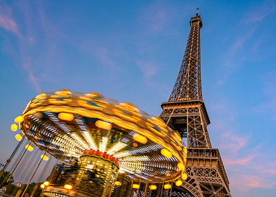 A Carousel Spins In Front of the Eiffel Tower