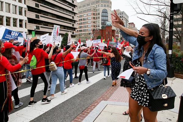 Pedestrians react to Burma protest
