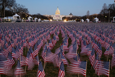 American flags wave in the wind as part of the 'Field of Flags' display on the National Mall on Monday, January 18, 2021. The art display is in lieu of a physical audience for the inauguration this year and includes nearly 200,000 flags representing every state and territory