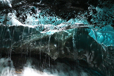 Dripping water from the ceiling of an Ice Cave at the Mendenhall Glacier outside of Juneau, Alaska