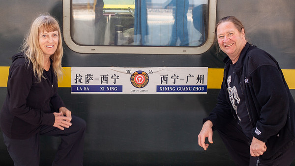 "Linda and I posing outside of our ""hard sleeper"" car on the Qinghai-Tibet railway.  The highest elevation railway in the world."