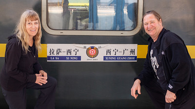 """Linda and I posing outside of our """"hard sleeper"""" car on the Qinghai-Tibet railway.  The highest elevation railway in the world."""