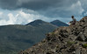 Hikers on Flume summit with views of Franconia Ridge, NH.