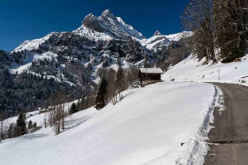 The road out of Braunwald passes under impressive scenery.