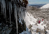 Hikers pass ice formations on the ascent of Mount Mansfield, VT.