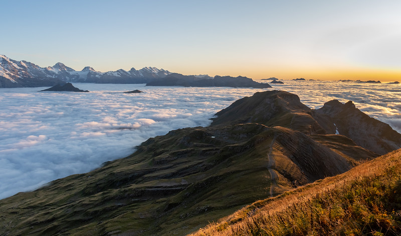 Sunset glow on the Berneralps seen from the Berghaus at Faulhorn, across an undercast.