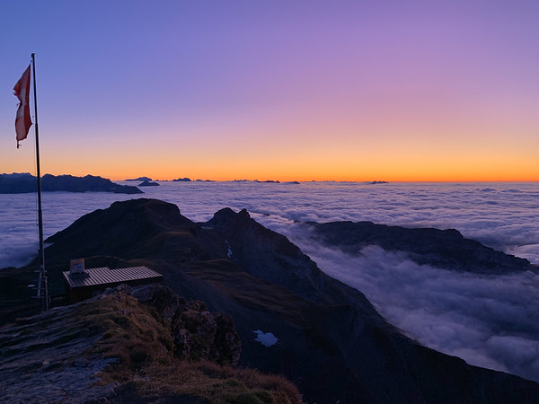 Sunset glow above the undercast, seen from near the summit of Faulhorn.