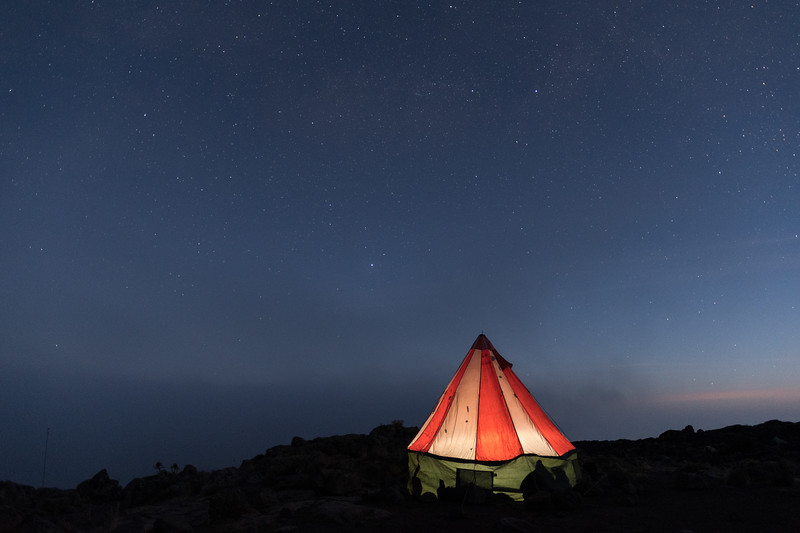 Dawn's earliest light and the night's latest stars, on the slopes of Mount Kilimanjaro.