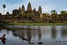 Children and reflecting pool in late afternoon light - Angkor Wat, Cambodia.