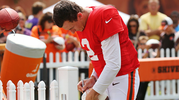 Cleveland Browns Quarterback Johnny Manziel takes time to sign autographs