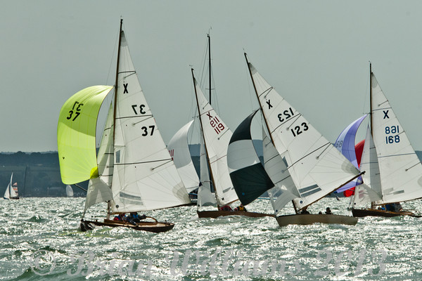 """cowes week 2013,  XOD one design x37 """"Ariel"""" , x123 """"Lara"""" , x119 """"Lone Star"""" and x168 """"Partparship"""" taking part in racing on day 8."""
