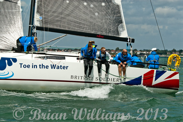 """Cowes week 2013, day 1,  J/111 class GBR8191r """"British Soldier"""" a Farr45 Atomic, toe in the water taking part in raceing."""