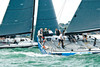 "Cowes week 2013, day 2,  Class IRC 1 yachts RUS2460 ""Bronenosec"" and GBR5252L ""Weapons of Choice at Royal Yacht Squadron start line."
