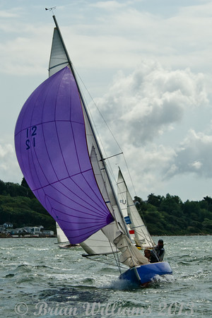"""Seaview mermaid u12 """"Amethyst"""" skippered by Charles Glanville and u6 """"Rosemary"""" skippered by Richard Prest taking part in racing on day 8 Cowes week 2013"""