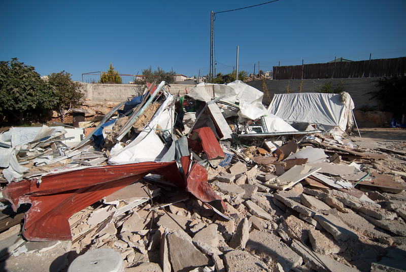 The wreckage of the demolished house of a Palestinian family 一個巴勒斯坦家庭的房子被拆毀後的殘骸