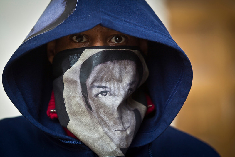 "A man wore hoodie and scarf depicting Trayvon Martin during the ""One Thousand Hoodies March for Trayvon Martin""  at the University of Minnesota. © STAR TRIBUNE"
