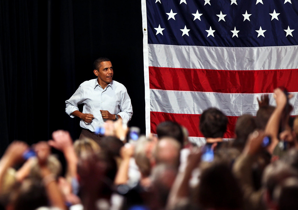 President Barack Obama enter a Health Insurance Reform Rally in a jog at the Target Center in Minneapolis. © STAR TRIBUNE