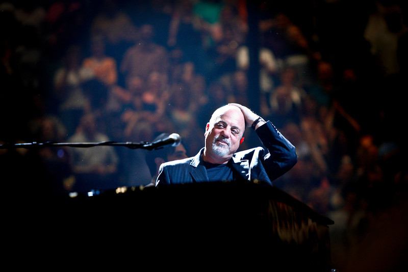 "Bill Joel rubbed his head in embarrassment as the crowd began singing ""Happy Birthday"" to him at the beginning of a concert at the Xcel Energy Center in St. Paul. © STAR TRIBUNE"