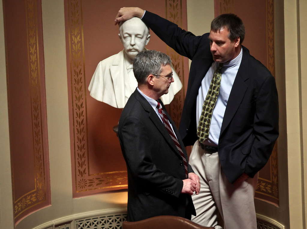 Sen. David Hann chatted with Sen. Chris Gerlach, who leaned on a bust of former Gov. Cushman Davis, at the start of a special session at the State Capitol. © STAR TRIBUNE