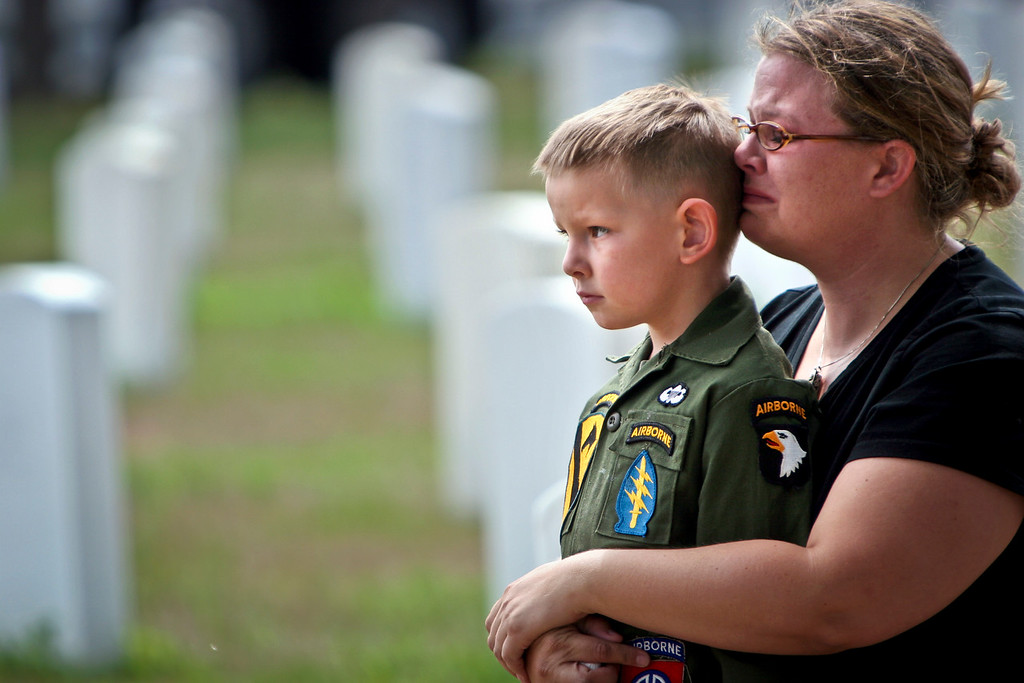 Katie Baker held her son Ian close as she became overwhelmed with emotion at the Airborne Circle 506th Parachute Infantry Regiment memorial ceremony at Fort Snelling. © STAR TRIBUNE