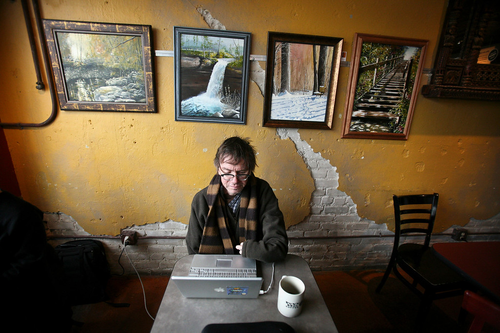 Minnesota author Kevin Kling spent the lunch hour writing on his computer at Dunn Brothers on Lake Street.  © STAR TRIBUNE
