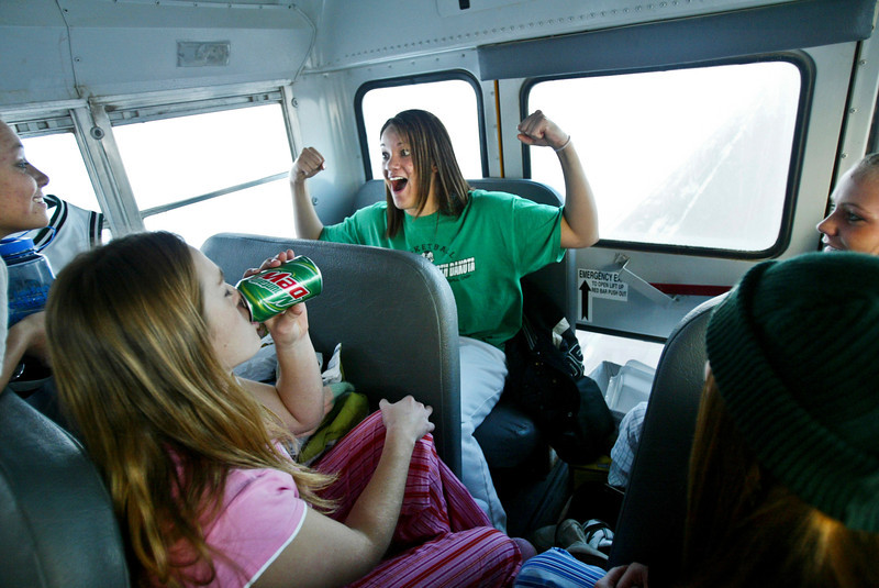 Greenbush senior star basketball player Kierah Kimbrough was the center of attention as she told a story during a bus ride to Lancaster for a game. © STAR TRIBUNE