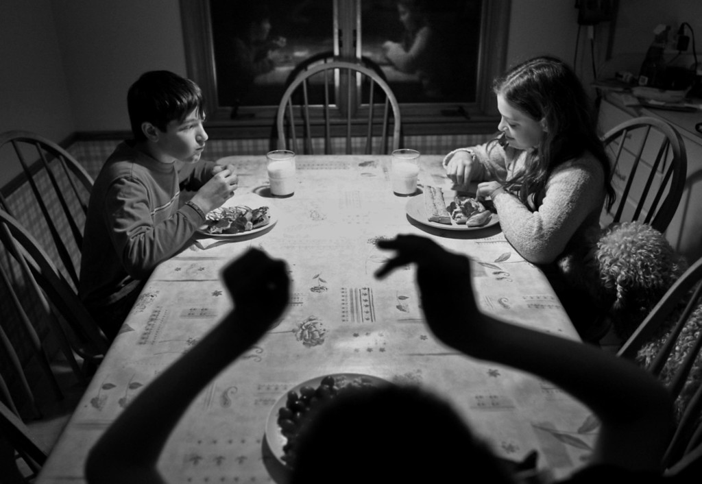 The twins Andy and Abby Guthmann ate dinner as the tried to ignore their disabled brother, Alex, as he flailed his arms.  © STAR TRIBUNE