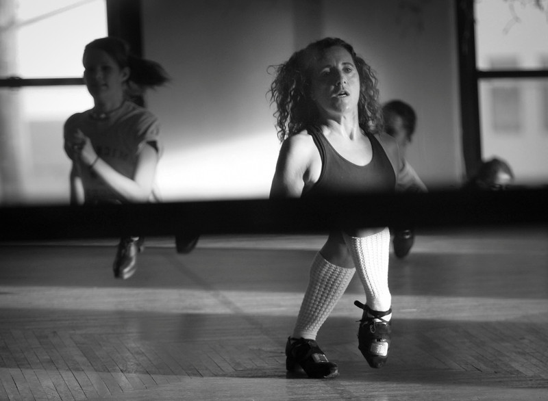 Kara Nasca watched her feet and upper body as she practices her Irish dancing by looking into positioned mirrors that only show the feet down and shoulders up. © STAR TRIBUNE