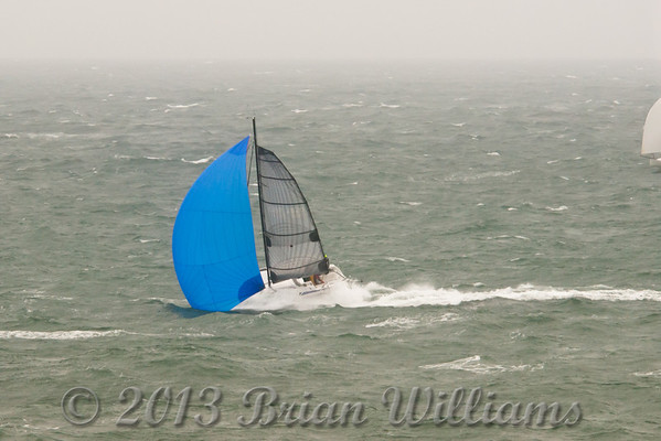 Images from the 2011 Round the Island Race.<br /> 1500 Yachts started but not all finished.<br /> Luckily the crew of this trimaran were rescued safely