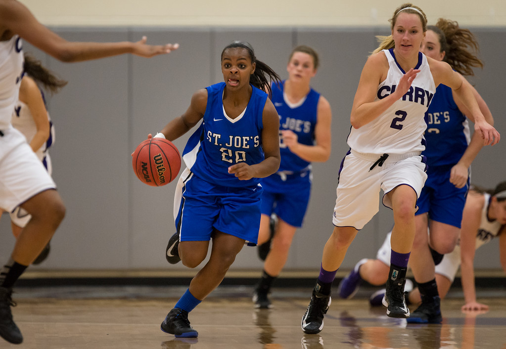 Sarah Assante (20) drives down the court during the Women's Basketball game between Saint Joseph's (ME) and Curry Collage at Curry College, Milton, Massachusetts, USA on November 16, 2013. Photo: Chris Poss
