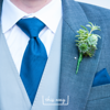 Detail shot of groomsman and beautiful wedding buttonhole. Edinburgh