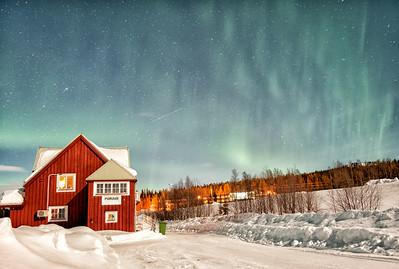 Porjus Station House Under the Aurora
