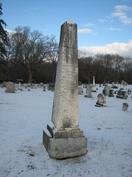The  Peters family monument, a marble obelisk about eight feet tall. Many family names are recorded on this shaft. Andrew Peters, the subject if this gallery, is the top inscription on the back of the monument.