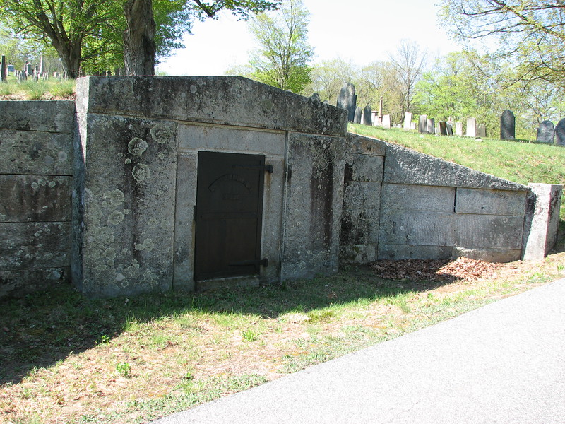 To locate the grave, enter the cemetery through the main gate, which is the first entrance off Cemetery Rd as you approach from Meetinghouse Hill Road. Not far into the cemetery, look for this hillside tomb on your left. Park here. The obelisk marking Dickey's grave is opposite this point, on your right.