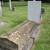Roger Enos' gravestone is the white one with the flag