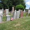 The Forward family row. Joseph's grave is marked by two stones, one on each side of the flag. His fathers' gravestone is the brown one two stones to the right. This grouping is about in the center of the cemetery.