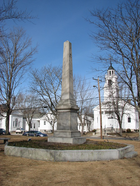 War memorial monument on the town common, in front of the Congregational Church. The names of the Revolutionary War soldiers from Hollis who gave their lives are listed on the face that is to the left and out of sight in this photo.