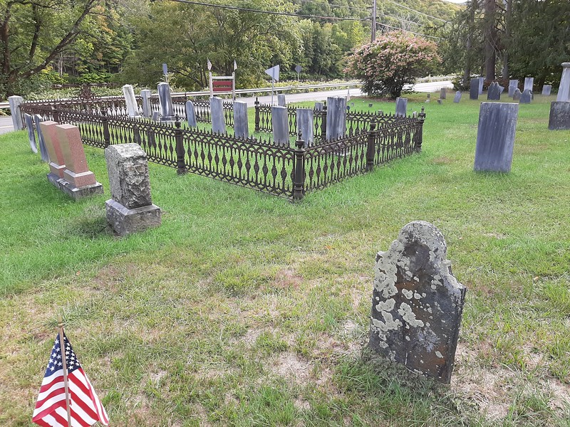 Oliver Sr.'s gravestone is in the foreground. To locate the grave, enter the cemetery via the stone steps, walk straight in along the wrought-iron enclosure seen here. The grave is 15 feet off the northeast corner of the enclosure.