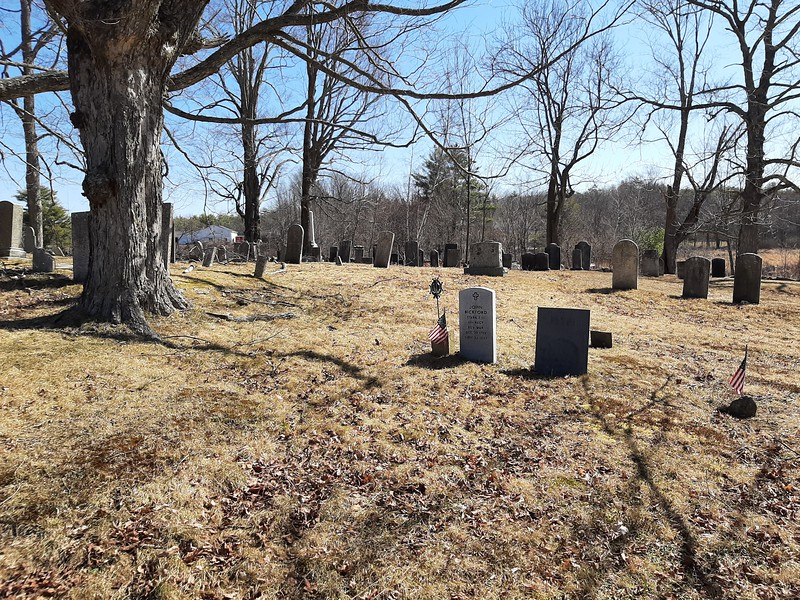 The setting of Bickford's grave, which is in the center of this photo. As you enter the cemetery, you will find the grave toward the left side of the cemetery about a third of the way from front to back.