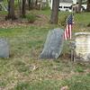 The gravestone of Samuel Blaisdell, on the right